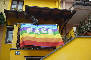 Aldo Capitini - The peace flag flown from a balcony in Italy