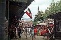 Bascarsija, ulica Saraci, háttérben a Havadze Duraka dzsámi minaretje és a városháza. Fortepan 74337.jpg