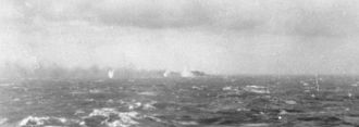 Last battle of the battleship Bismarck - The Final Battle, 27 May 1941. Surrounded by shell splashes, Bismarck burns on the horizon.