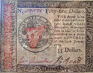 Early American currency - A fifty-five dollar Continental issued in 1779.
