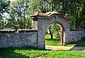 Bezno, gateway by church.jpg