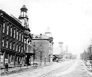 Clarissa C. Cook Library/Blue Ribbon News Building - The Clarissa C. Cook Library is the third building on the left in this 1880 photograph.