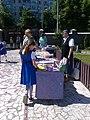 Bucuresti, Romania. Un stand de carti in incinta Bisericii Sfanta Tereza a Pruncului Isus. Eleva interesata de carti.jpg