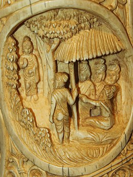 Buddha visiting his five old friends Roundel 26 buddha ivory tusk.jpg