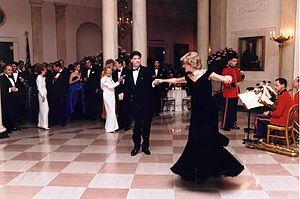 Photograph of Princess Diana dancing with John...