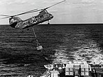 CH-46D Sea Knight of HC-6 replenishes USS Caron (DD-970), in 1981.jpg