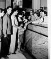 """CITIZENS STANDING ON LINE AT THE ANGLO PALESTINE BANK IN TEL AVIV, IN ORDER TO DONATE MONEY TO THE """"KOFER HAYESHUV"""" FUND OF THE HAGANA. הבנק האנגלו- פD403-007.jpg"""