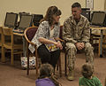 CO opens a book to begin the Month of the Military Child 130402-M-XW721-028.jpg