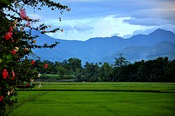 Brgy. Camangcamang with Mabinay Mountains in the distance