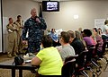 Capt. Christopher Martin, addresses the Naval Station Guantanamo Bay evacuees during a town hall meeting. (30159058466).jpg