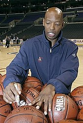 A basketball player is signing a basketball
