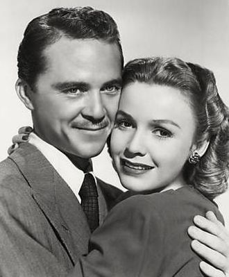 Mary Anderson (actress, born 1918) - Anderson with actor Charles Russell in Behind Green Lights (1946)