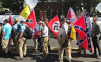 "Alt-right - Prominent alt-rightists were instrumental in organising the ""Unite the Right"" rally in Charlottesville, Virginia in August 2017. Here, rally participants carry Confederate battle flags, Gadsden flags and a Nazi flag."