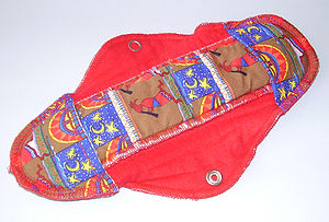 Sanitary napkin - Reusable cloth menstrual pad with Kokopelli motif.