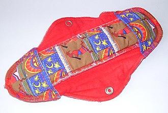 Sanitary napkin - Reusable cloth menstrual pad with Kokopelli motif.