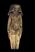Ushabti of a Concubine; along with the naked body, jewelry underlying the breasts and shaved pubis with visible vulva, the heavy wig give the erotic connotation to the statuette. Painted wood, Middle kingdom.