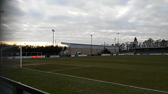 Corby Town F.C. - Athletics ground side with changing rooms and former stand