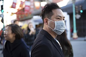 Person wearing a mask in Chinatown, San Francisco, California.