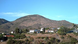 """Cowles Mountain - Cowles Mountain as seen from San Diego. A remnant of the """"S"""" can be seen near the summit."""