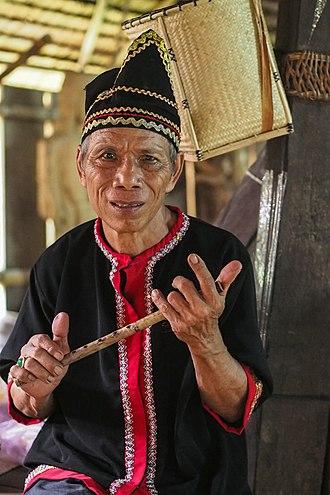 Bidayuh - A Bidayuh man with a flute from Sarawak, Malaysia.