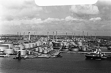Refinery with several tanks and a bay in the foreground
