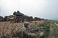 DA-ST-86-00224 Three M2 Bradley advance through a wooded area during Exercise REFORGER '85.jpeg