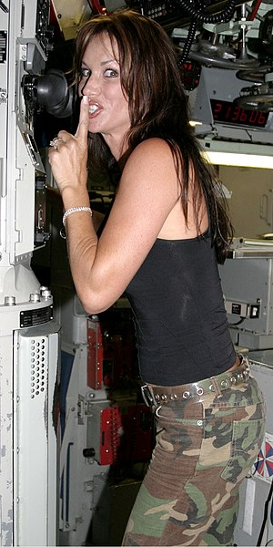 Debbe Dunning - Debbe peeking through the periscope aboard USS Key West at Pearl Harbor, Hawaii on August 11, 2003.
