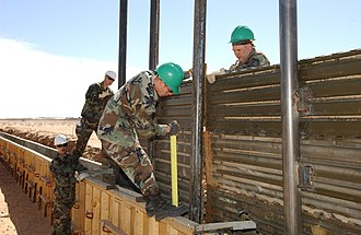Operation Jump Start - U.S. airmen construct a portion of a fence along the Mexican border in San Luis, AZ (March 5, 2007)