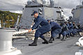 Defense.gov News Photo 100930-N-2855B-251 - U.S. Navy sailors aboard the guided missile destroyer USS Bainbridge DDG 96 haul in a mooring line while mooring the ship in Faslane Scotland on.jpg