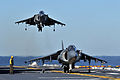 Defense.gov News Photo 120119-N-UM734-730 - Two AV-8B Harrier II aircraft assigned to Marine Attack Squadron 542 conduct flight operations aboard the USS Kearsarge LHD 3 in the Atlantic Ocean.jpg