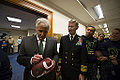 Defense Secretary Chuck Hagel autographs a game ball during a pep rally for the U.S. Naval Academy Midshipmen before the upcoming Army-Navy football game at the Pentagon 141211-D-AF077-153b.jpg