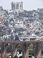 Detail of Aqueduct with City Backdrop - Queretaro - Mexico (44646413370).jpg