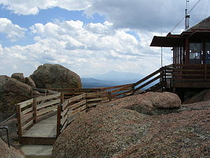 Devil's Head Lookout - A picture of the watchtower with Pikes Peak in the background.