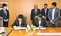 Dharmendra Pradhan and the Minister of Health, Labour and Welfare of Japan, Mr. Katsunobu Kato signing a Memorandum of Cooperation (MoC) between India and Japan on Technical Intern Training Programme (TITP), in Tokyo, Japan.jpg