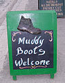 Dirty boots welcome in Malham.JPG