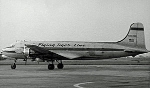 Flying Tiger Line - Flying Tiger Line Douglas C-54A Skymaster at Manchester Airport, England in May 1955