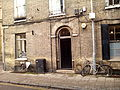 Downing Street toward Pembroke Street, two bikes, Cambridge, UK, january 2015.jpg