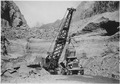 Dragline excavator working in dam substructure excavation at approximate elevation 550. Note deposition of river... - NARA - 293825.tif