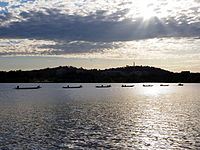 Dragon boats being towed on Lake Burley Griffen