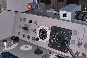 Driver's reminder appliance - The DRA is the bright red button at top left of the driver's desk.