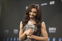 Wurst holds the Eurovision trophy after winning.
