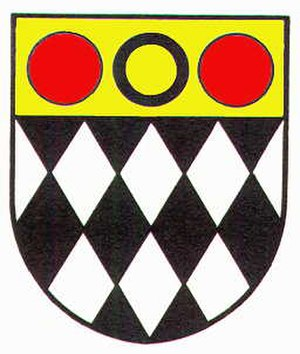Eastwood, Nottinghamshire - Coat of arms of the former Eastwood urban District Council. The black diamonds represent coal mining, the annulet is from the heraldry of the Plumtree family and the red roundels are from the arms of the Grey family of Codnor.