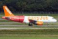 EasyJet (Tartan livery), G-EZBF, Airbus A319-111 (16653086819).jpg
