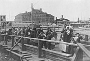 Ellis island in 1902, the main immigration port for immigrants entering the United States in the late 19th and early 20th centuries.