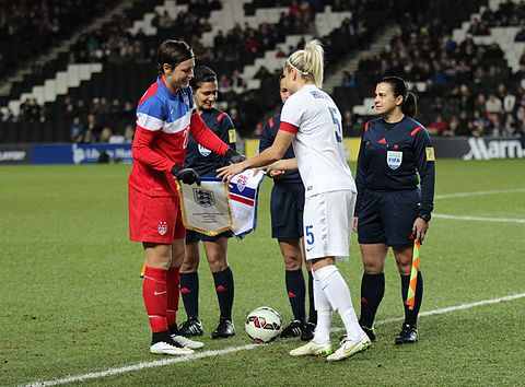 Wambach and England captain Steph Houghton shake hands before kick off on February 13, 2015 England Women's Vs USA (18500761141).jpg