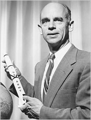 Ernst Stuhlinger - Ernst Stuhlinger holds a model of the Juno I rocket used to launch the first U.S. satellite, Explorer I.