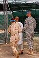 Escorting a camp one captive.jpg
