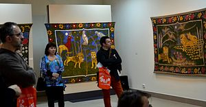 Alena Kish - Visitors look at the works of Kish at an exhibition in Minsk in 2013.