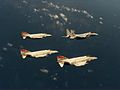 F-4S Phantoms of VF-161 in flight with 18th TFW F-15C Eagle c1983.jpg