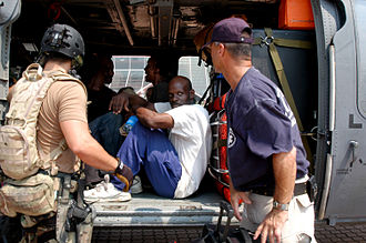 Federal Emergency Management Agency - A DMAT member assures a rescued man that the trip to the airport will be safe.
